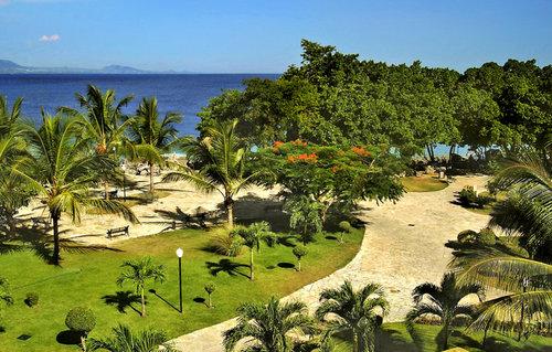 Ort Sosua Lage & Umgebung Auf einem Felsplateau direkt oberhalb einer Strandbucht gelegen. Das Ortszentrum von Sosua mit Bars, Restaurants und ...